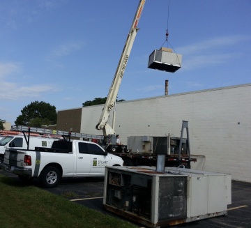 Stuart Mechanical truck installing new HVAC unit